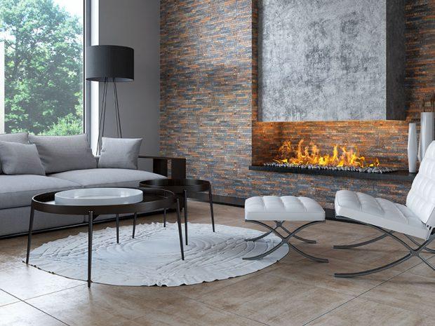 Kominek w salonie inspirowanym betonem